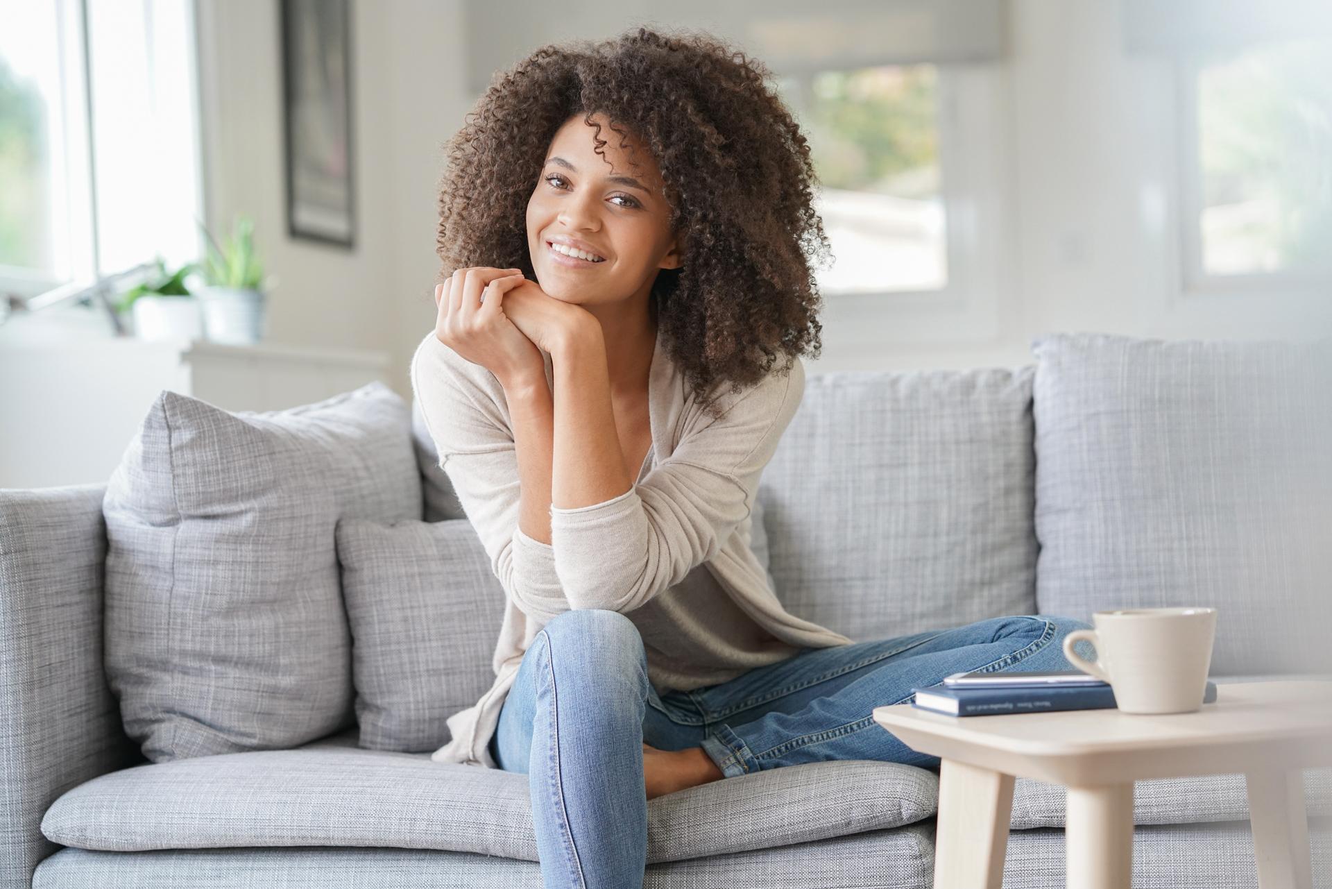 Beuatiful mixed race woman relaxing in sofa