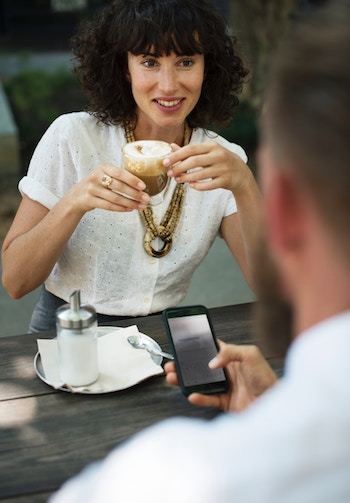 Girl drinking cofee on date
