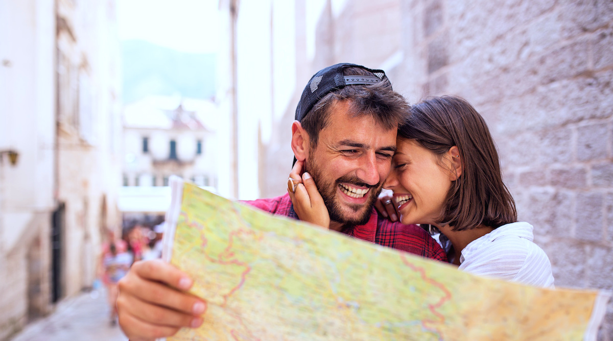 Happy love tourist couple using map at travel,exploring new town